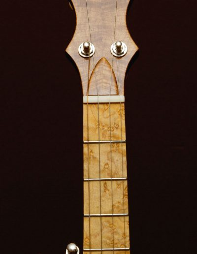 Birds Eye Maple Fingerboard with book matched Maple head cap laminate with ebony inlays