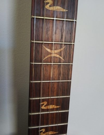 Close Up of BirdsEye Maple Inlays