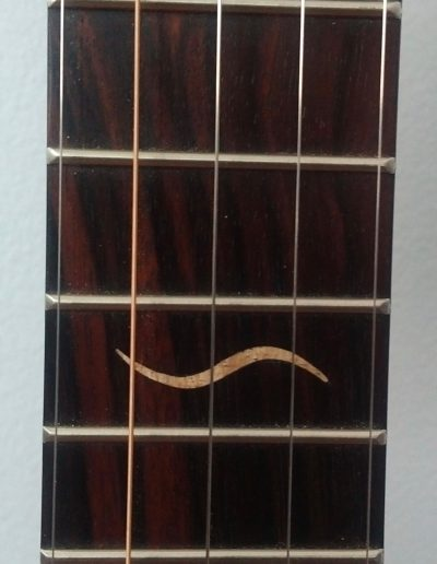 Curly Maple Inlays of Pattison Logo River Fish on Ebony Fingerboard
