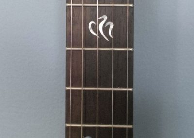 Great Northern Loon Rosewood Fret board with Mother of Pearl Inlays