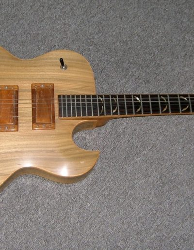 Gumwood Carved Top and Back Electric Guitar